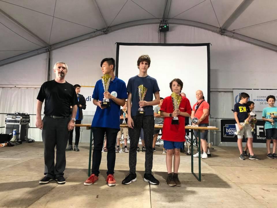 Le podium du 7e Blitz Ghjustra Europea: Stefano Yao, Anatole Vlachos, Augustin Droin